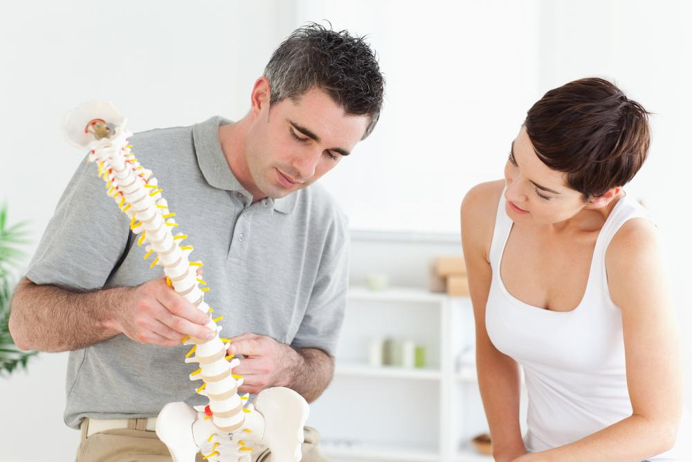 Woman discussing chiropractic care with the doctor.